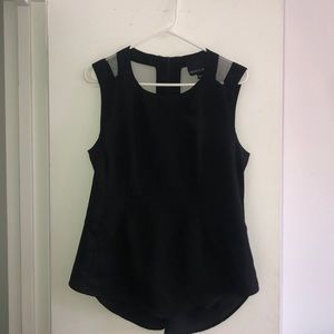 Black sleeveless top with sheer back